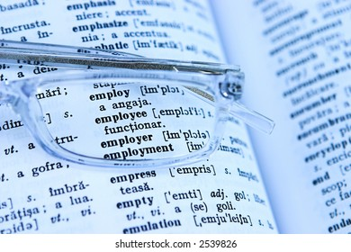 Close up of employment in a dictionary - shallow depth of field