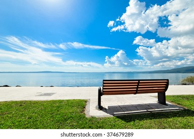 Close up of a empty bench on Lake Bracciano in Italy
