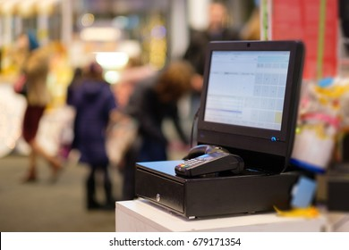 Close up of empty cash desk with computer screen and card payment terminal in small store