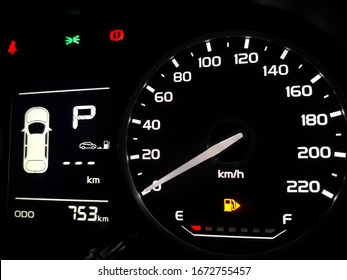 close up empty petrol, gasoline gauge dashboard in car with digital warning sign. low lavel of fuel show on speedometer dashboard.