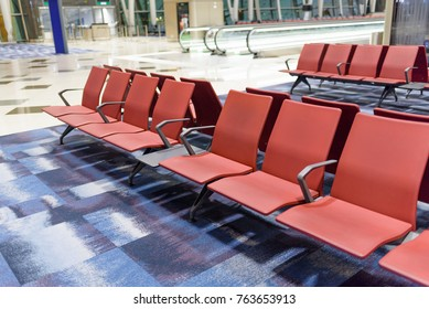 Close up of empty seats for people in the departure area