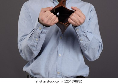 Close up Empty wallet in man's hands. no money. pay the debt. Bankruptcy concept. after black friday or tax audit