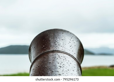 Close up of the end of a barrel of an antique ship canon weapon on the Marlborough Sounds in Picton, New Zealand.