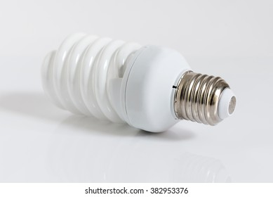 Close up of a energy saving fluorescent light bulb on a white background