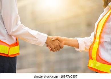Close up engineer shake hand on site construction , Shake hand ,hand shake concept
