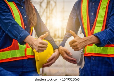 Close up Engineer or Technician Foreman Supervisor Holding Hardhat Safety and Thump up work success project