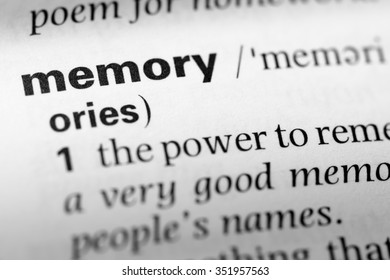 Close up of English dictionary page with word memory