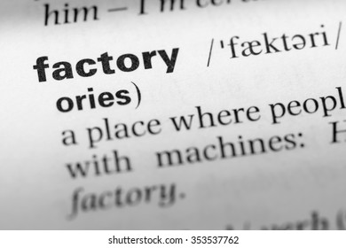 Close up of English dictionary page with word factory
