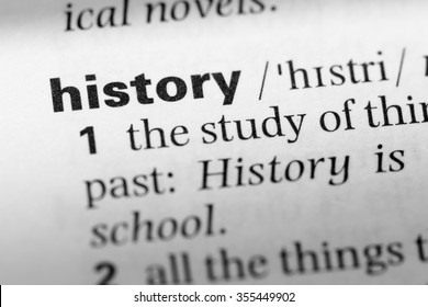 Close up of English dictionary page with word history