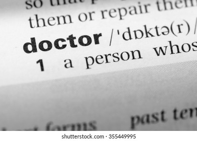 Close up of English dictionary page with word doctor