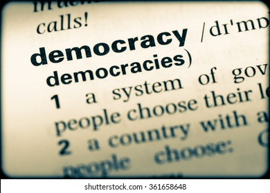 Close up of English dictionary page with word democracy