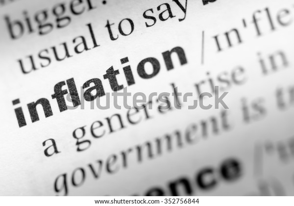 Close up of English dictionary page with word inflation