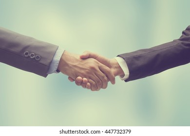 close up executive business man meeting handshake together after meeting about agreement contract on blur background, investor businessman shake hand agenda financial synergy concept