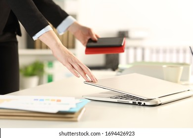 Close up of executive hands leaving office closing laptop taking phone and agenda