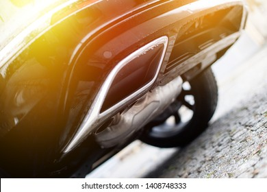 Close up of an exhaust pipe of a car, environmental pollution