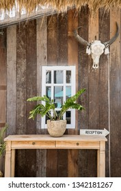 Close up of exotic  wooden reception desk sign in a tropical motel. Tourism and hospitality concept