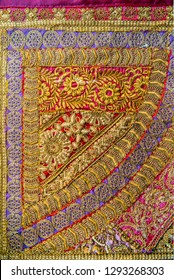 Close up of an exquisite piece of fabric which has an intricate work of embroidery. Indian traditional fabric and textile.