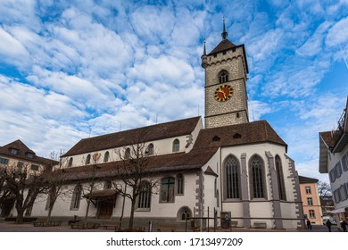 Close up exterior view of the St. Johann evangelic church in the old town of Schaffhausen city center on sunny day in autumn with blue sky cloud in background, Switzerland