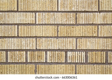 Close Up of an Exterior Wall of Yellow Bricks with Ridges
