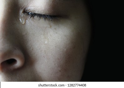 Close up eye of Asian woman crying with tears