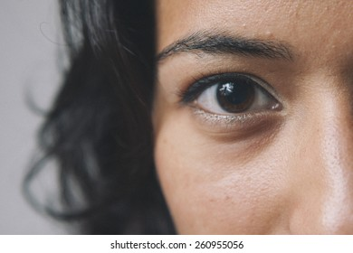 Close up of an eye of a South Asian woman.