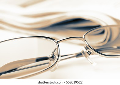 Close up eyeglasses with newspaper