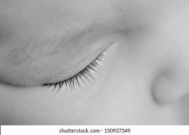 Close up of the eyelash of Newborn baby  sleeping. Black and White.