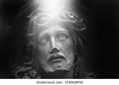 Close up eyes full of pain. Fragment of an ancient statue of  Jesus Christ crown of thorns . Religion, faith, death, resurrection, eternity concept