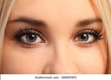 Close up eyes of young attractive blonde girl