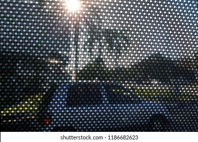 Close up fabric made sunshade in the car side window