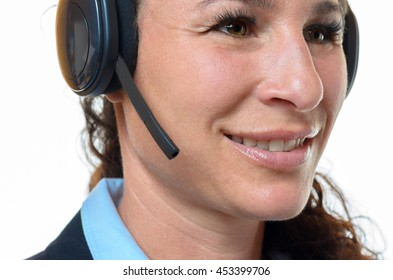 Close up of the face of an attractive smiling businesswoman wearing a headset conceptual of a secretary, client service, support, receptionist or personal assistant isolated on white