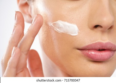 Close up of the face of a beautiful girl with perfect skin and clean all impurities thanks to moisturizing creams both anti-aging and night and day. Concept of beauty, creams,skincare and clear.