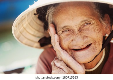 Close up face of beautiful smiling woman with wrinkles. Elderly senior.
