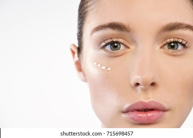 Close up of the face of a beautiful woman with perfect skin thanks to creams to keep young and cream contour anti-aging and wrinkle eyes. Concept of: beauty, cleanliness and perfection
