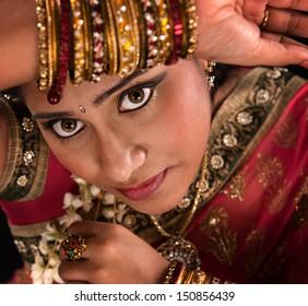 Close up face of beautiful young Indian woman in traditional sari dress
