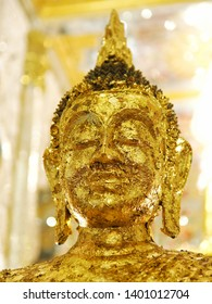 Close up the face of Buddha statue gilded in the temple.Holyday in Thailand.