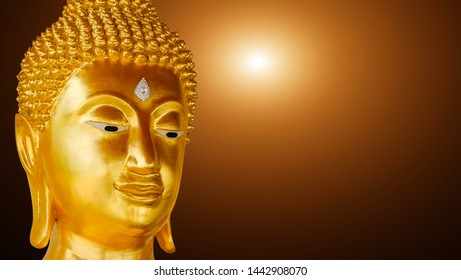 Close up face of Buddha statue golden (Thailand)