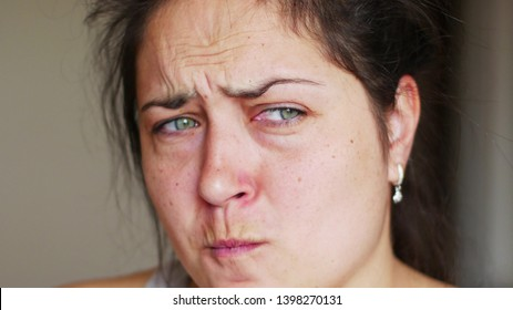 Close up face of crying woman. Upset crying woman wiping tears close up. Pain, stress, desperation.
