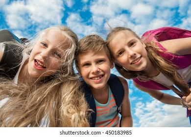 Close up of face of happy children while laughing.