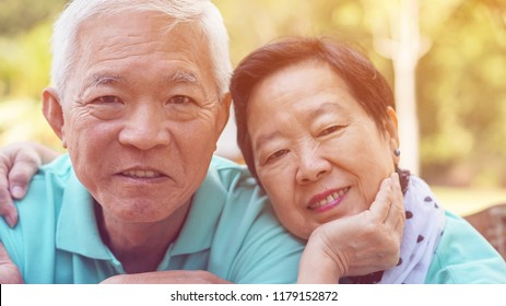 Close up face happy eldery Asian couple smile together