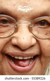 Close up face of a happy Indian senior lady
