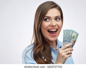 Close up face portrait of smiling woman holding money dollar cash. Isolated portrait.