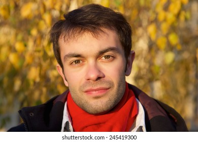 Close up face portrait of a young man with scarf