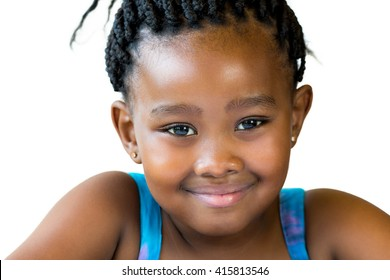 Close up face shot of cute smiling african girl with braided hair isolated against white background.