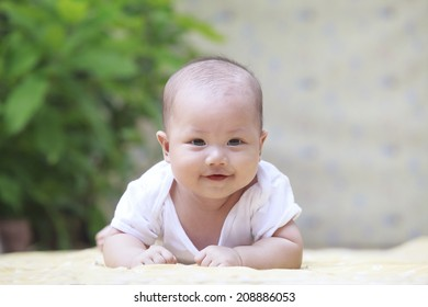 close up face of smiling baby lying on soft bed at home terrace use for infant and newborn,kid and motherhood topic