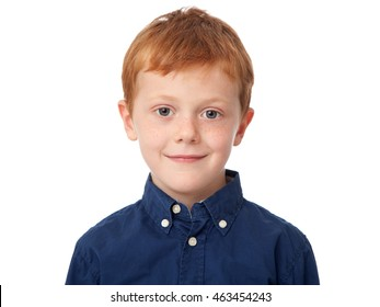 Close up face of a smiling ginger boy isolated on white background