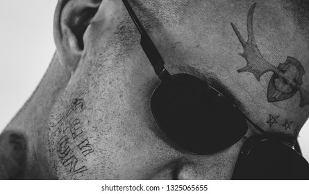 Close up of face tattoo.