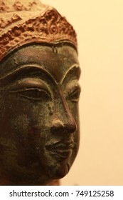 close up the face of thai angel statue and brown background
