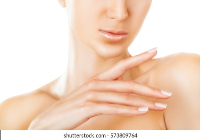 Close up of the face well-groomed young woman and beautiful hands on a white background. Focus on hand