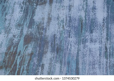 close up of faded blue vertical paint streak abstract pattern